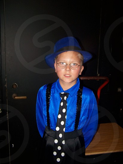 boy wearing a blue fedora hat and polka dot tie photo