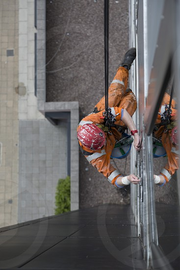 Abseiling window cleaner photo