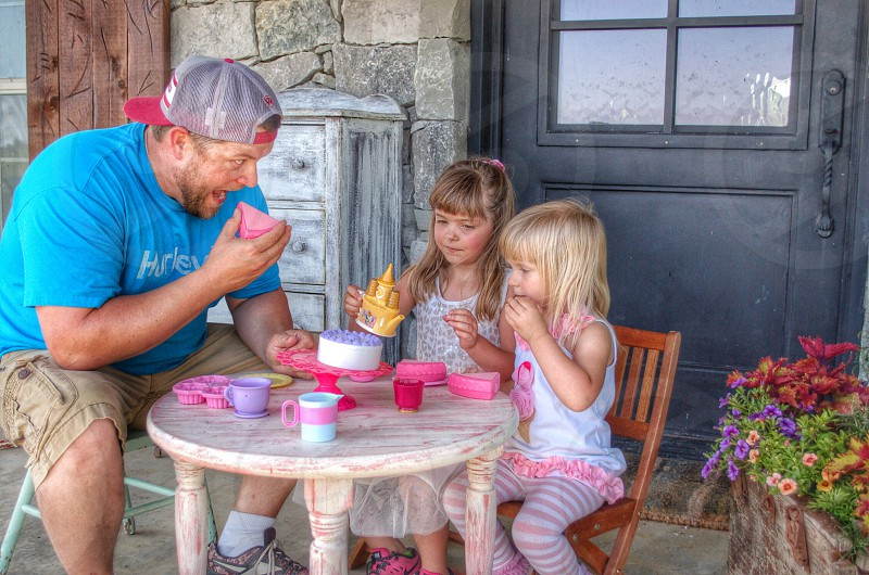 Tea party time for daddy and the littles. photo