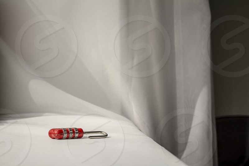 Red number padlock on white cloth background. photo