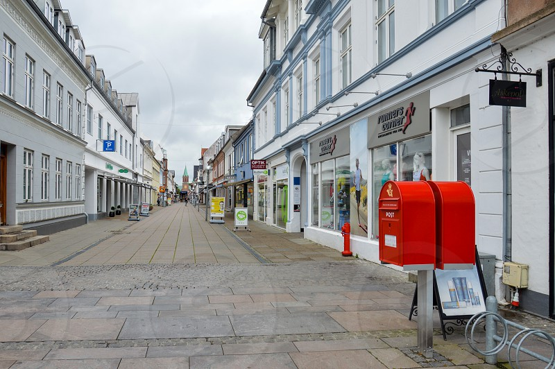 Local shops along Vestergade Street leading to Silkeborg Church located at the town centre of Silkeborg a municipality in East Jutland metropolitan area in Denmark photo