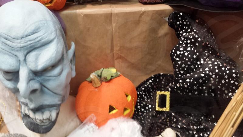 master mas beside jack-o-lantern and witch hat photo