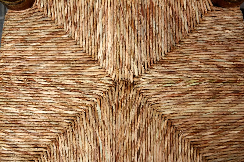 enea chair seat handcrafted with traditional dried reeds grass in Spain photo