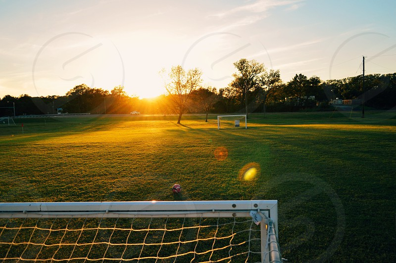 Soccer field at sunset. photo