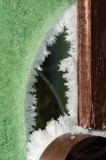 brown wooden board with ice on edge photo