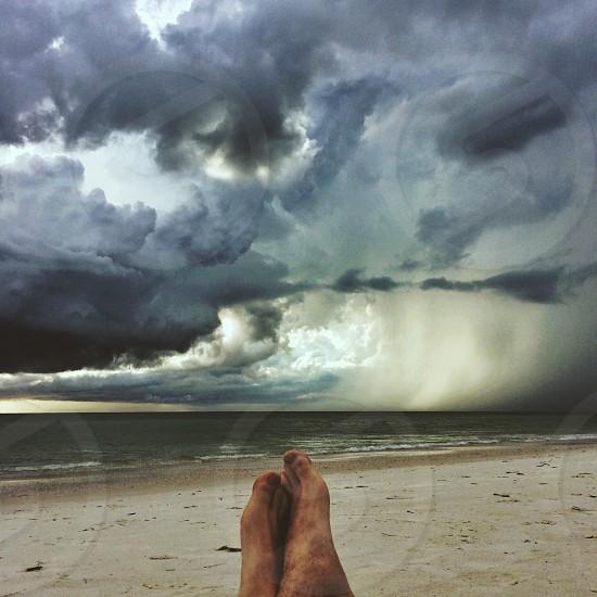 rain falling near seashore view photo