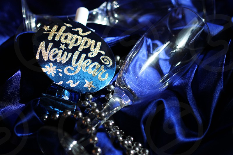 new year festive glass party satin blue happy celebrate photo