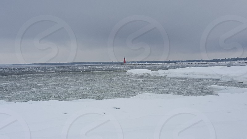 lighthouse winter snow ice lake Northern Michigan photo