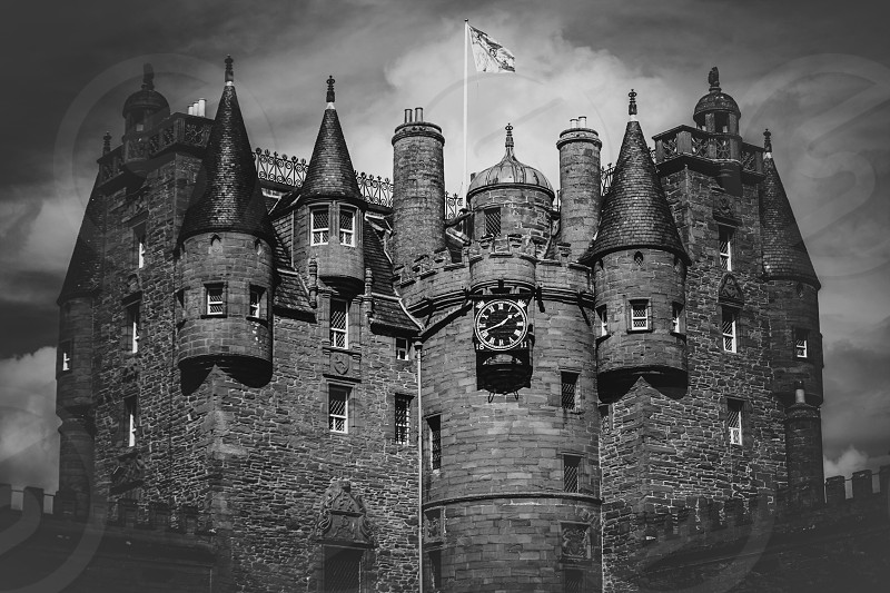 greyscale photography of castle photo
