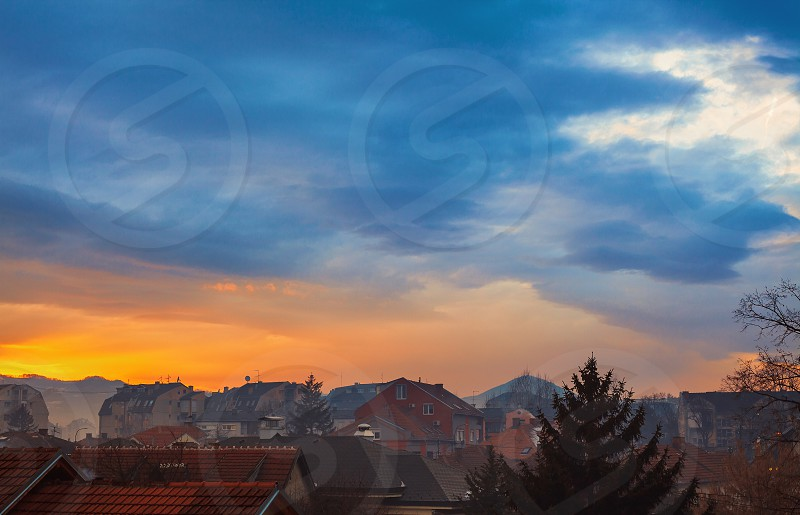 Beautiful cloudy and colorful sky over small Balkan city winter season.  photo