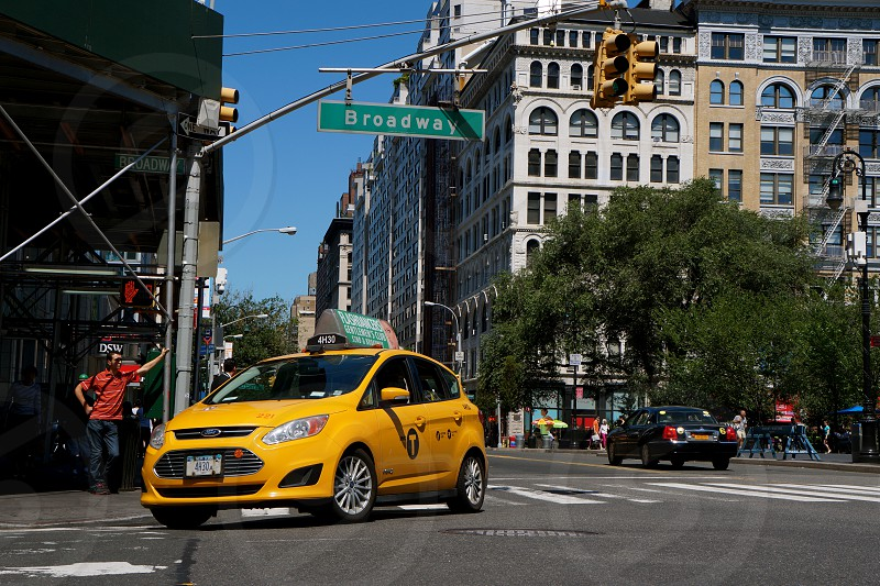 yellow taxi cab on broadway street photo
