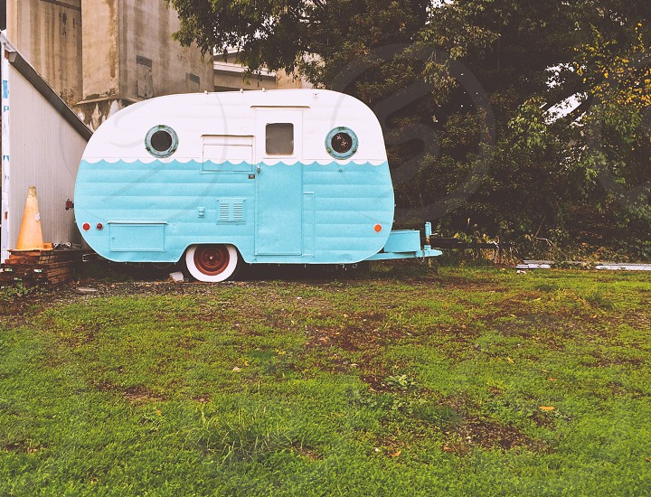 Vintage trailer on a grassy lawn photo