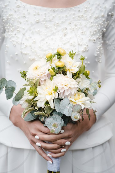 Bride holding bouquet of flowers after ceremony photo