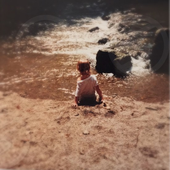 Toddler; water; creek; playing; discovering; nature  photo