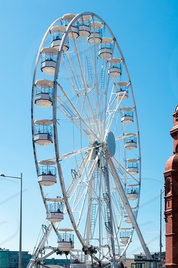 CARDIFF/UK - AUGUST 27 : Ferris Wheel in Cardiff on August 27 2017. Unidentified people photo