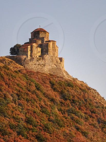 brown concrete church on mountain cliff photo