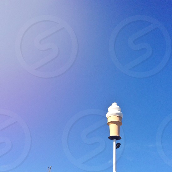 white and beige cream shake on cup pole accessory photo