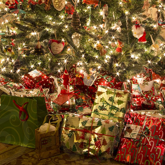 Close up of presents under a Christmas tree photo