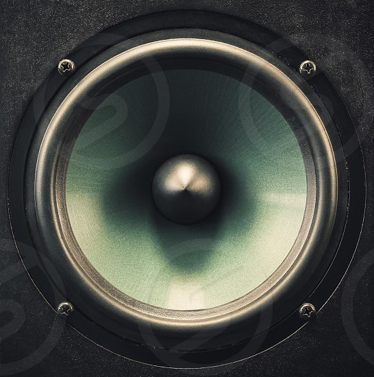 Metallic material of a woofer speaker closeup details and of a membrane.  photo