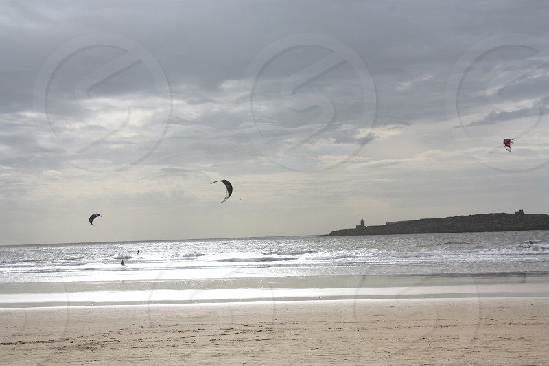 Windsurfing at sunset in Essaouira Morrocco. photo
