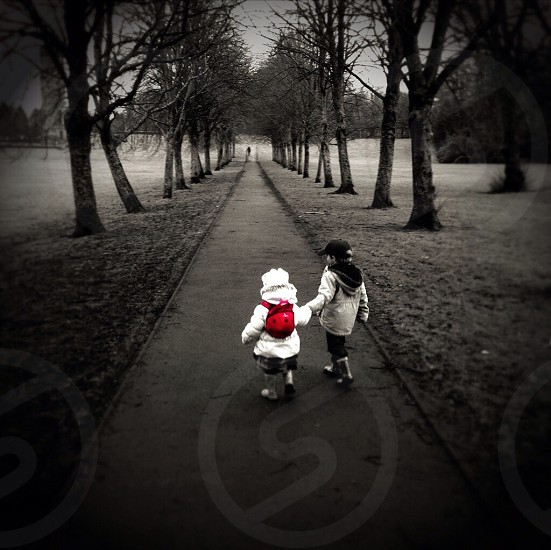 Kids happy walk winter holding hands brother sister love photo