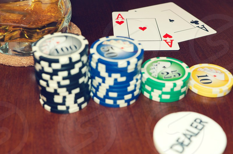 ace aces addiction bet betting black button card cards chance chip chips close close-up color dealer drink em gamble gambling game games glass heart hold leisure luck nobody pair photography play playing poker red risk spades stack success table texas up white win wooden  photo