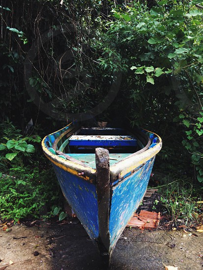 blue and grey wooden canoe photo