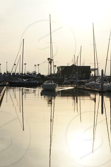 white speed boat on docking station photo