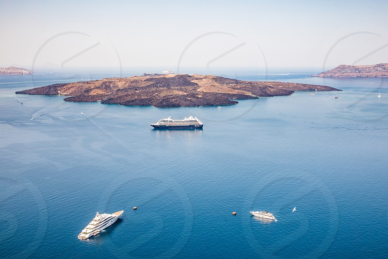 Top View Of The Caldera And Cruise Ships In The Sea On Famous Greek Island Santorini photo