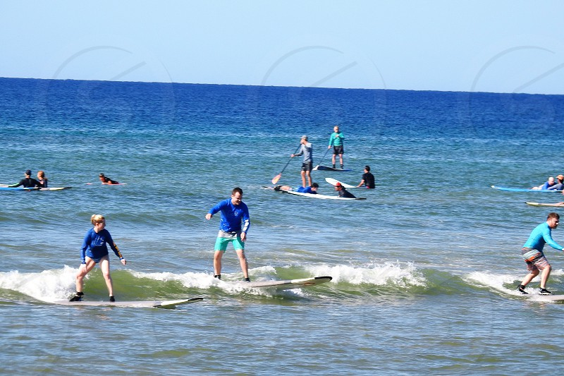 Beginners catching the small waves at Po'olenalena Beach Maui          photo