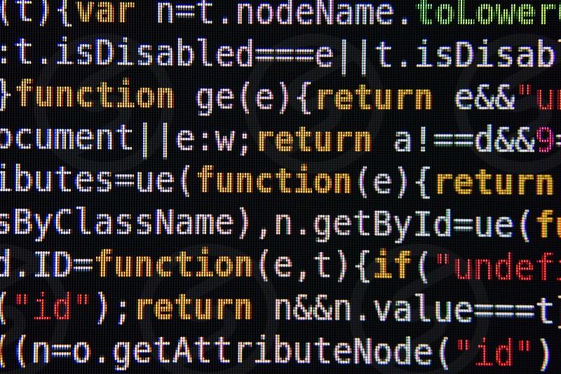 Yellow Red and White Program Source Code Segment on Black Screen Closeup photo