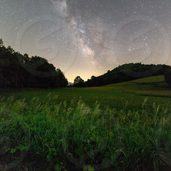 Milky Way in a country field photo