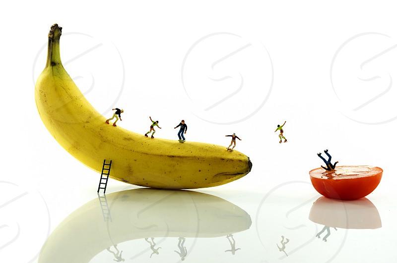 skating little world  people on yellow banana photo