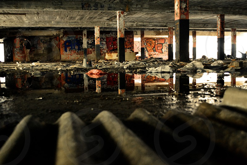 Puddle reflection abandoned parking old bowling alley Steglitz Berlin photo