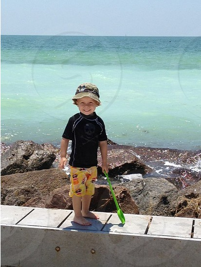 boy standing and smiling photo