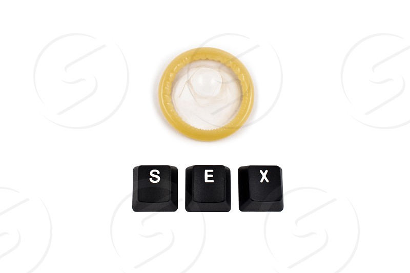 Condom. Sex sign stock images. Word sex on computer keyboard. Keyboard buttons on a white background photo