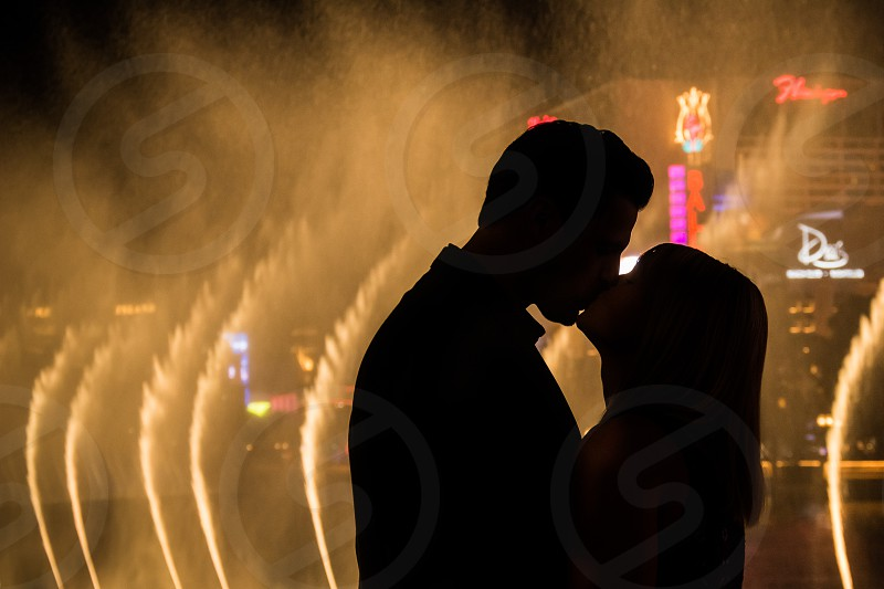 Romantic kiss in front of the Bellagio Fountains in Las Vegas photo