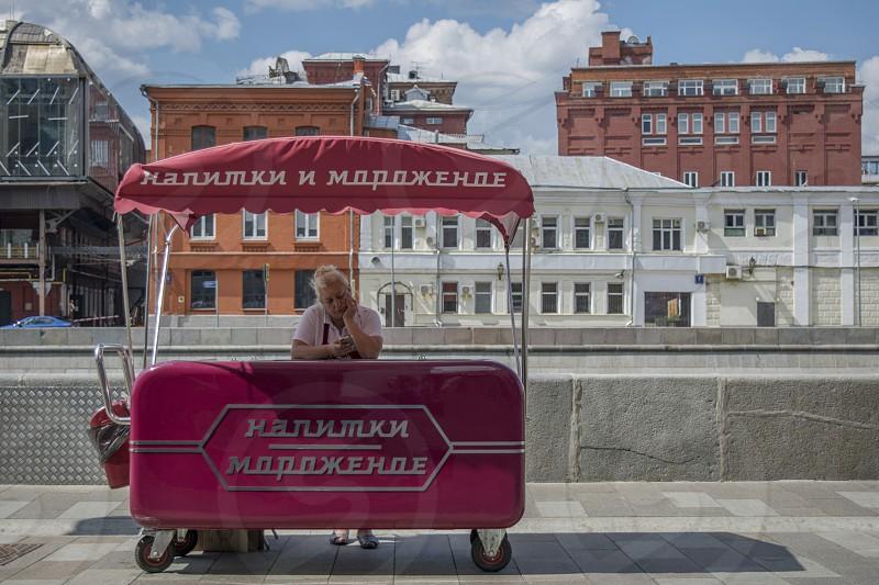 Street food ice cream cart on the promenade photo
