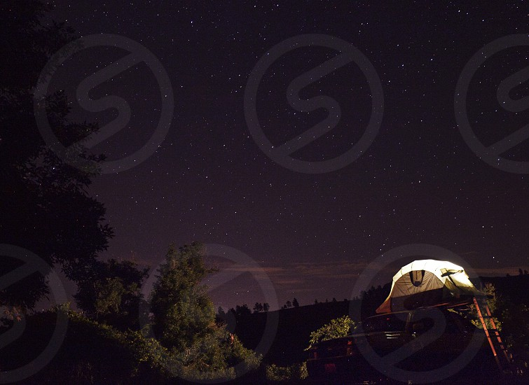 Campers in a pop up tent over a pickup in Beulah Wyoming. photo