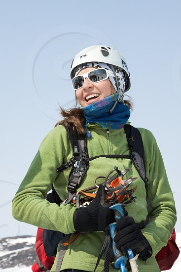 AVACHINSKY VOLCANO KAMCHATKA PENINSULA RUSSIA - APRIL 21 2012: Portrait of smiling young woman equipped ski mountaineer - participating in Open Cup of Russia on Ski Mountaineering on Kamchatka. photo