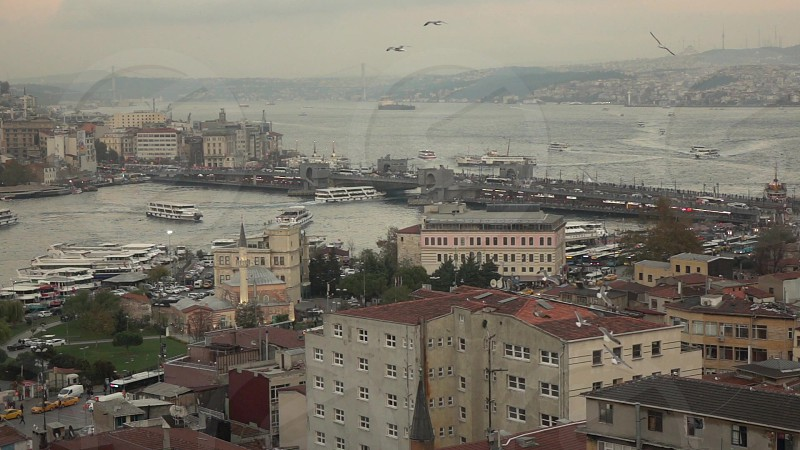 Panoramic Istanbul cityscape with building view to Bosphorus strait with shiping traffic Galata bridge in a cloudy summer day at sunset. Slow motion Full HD video 240fps 1080p. photo