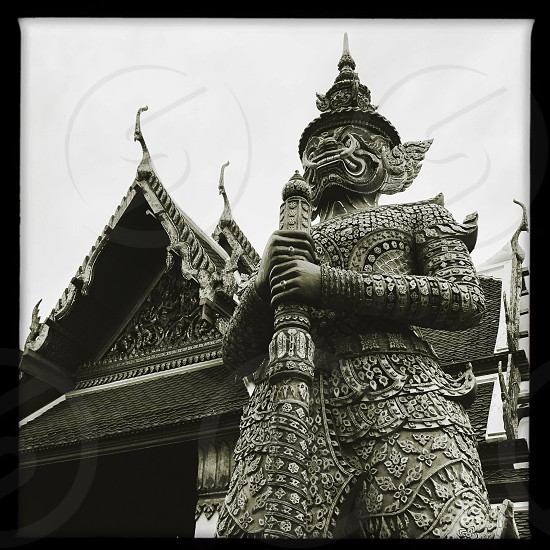 Outdoor day black and white monochrome vertical portrait Grand Palace Bangkok Thailand Kingdom travel tourism tourist wanderlust gold gold leaf Buddhist Buddhism holy royal regal monarchy temple temples mosaic mirror tile tiles ornate shrine royal regal royalty attraction guard imperial elaborate decorative decoration square filter photo