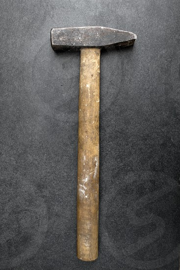 Old used hammer on table photo