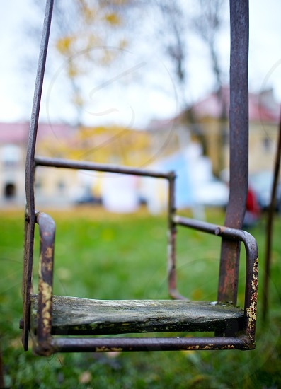 The broken child's swing. Unhappy childhood photo