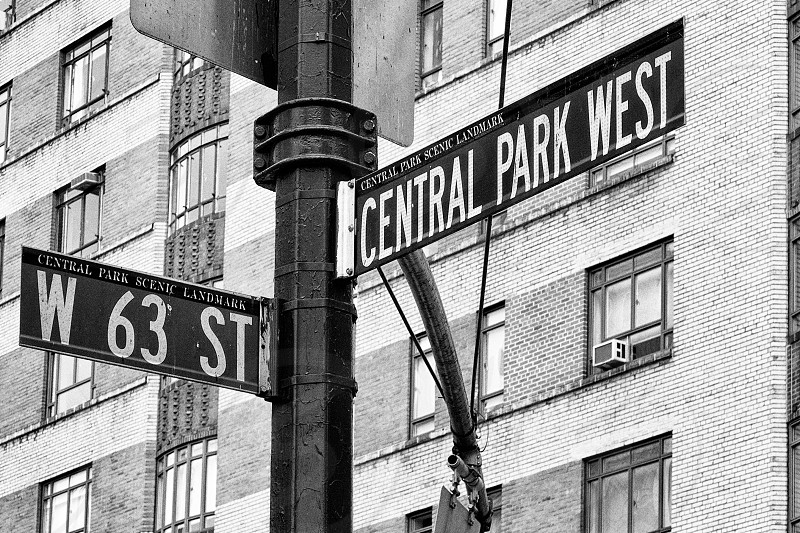 greyscale photography of central park west post sign photo