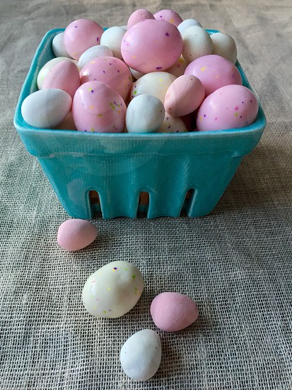 Easter eggs candy chocolate pink white Aqua turquoise linen fabric ceramic carton table decor decoration holiday festive spring photo