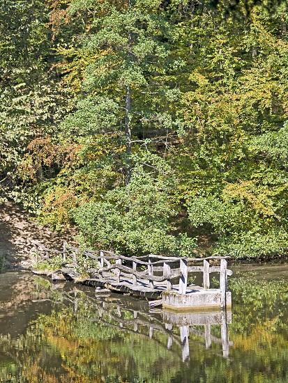 lake with old wooden bridge photo