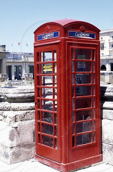 Brithish Telephone Cabin in the old Town of Valletta on Malta in Europe. photo