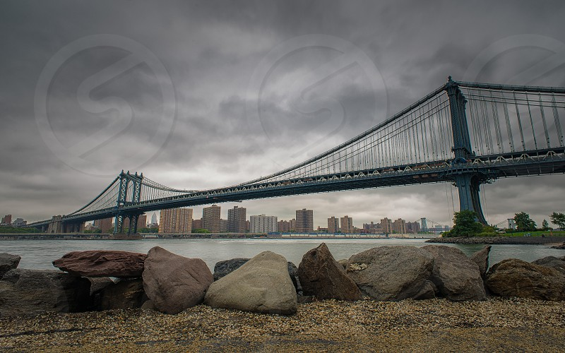 brooklyn bridge view from shore photo