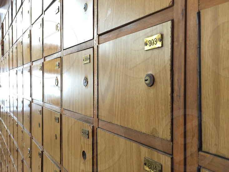Old postal wooden mailboxes photo